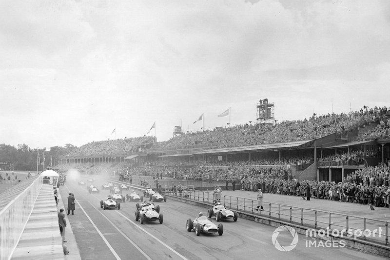 Jean Behra, Maserati 250F, leads Stirling Moss and Tony Brooks, Vanwall