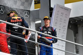 Max Verstappen, Red Bull Racing, 1st position, and Daniil Kvyat, Toro Rosso, 3rd position, celebrate with Champagne on the podium