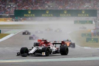 Kimi Raikkonen, Alfa Romeo Racing C38, leads Sebastian Vettel, Ferrari SF90