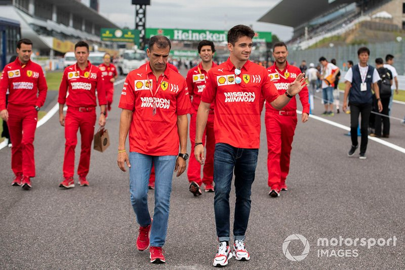 Charles Leclerc, Ferrari walks the track with Marc Gené