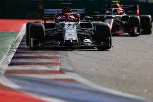 Kimi Raikkonen, Alfa Romeo Racing C38, leads Alex Albon, Red Bull RB15