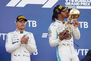 Valtteri Bottas, Mercedes AMG F1, 2nd position, and Lewis Hamilton, Mercedes AMG F1, 1st position, celebrate on the podium