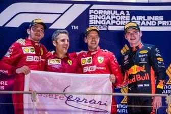 Победитель Себастьян Феттель, второе место – Шарль Леклер, Ferrari, третье место – Макс Ферстаппен, Red Bull Racing