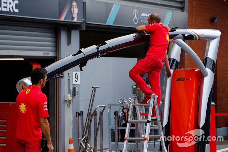 Ferrari team members at work in the pitlane
