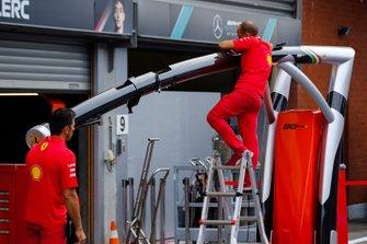 Ferrari team members at work in the pitlane