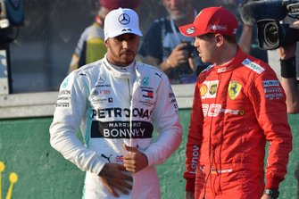 Lewis Hamilton, Mercedes AMG F1, and Sebastian Vettel, Ferrari, talk after qualifying