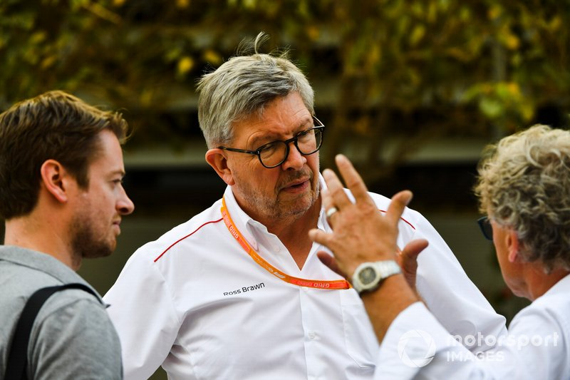 Dr Carsten Tilke, Ross Brawn, Managing Director of Motorsports, FOM and Hermann Tilke in the paddock.