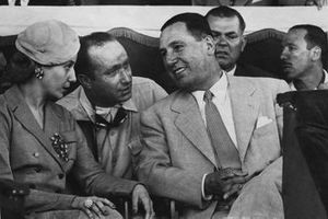 Juan Manuel Fangio, Mercedes, retired, explains his retirement to the President Juan and Madame Eva Peron in the grandstand