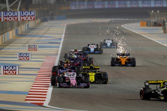 Sergio Perez, Racing Point RP19, leads Nico Hulkenberg, Renault R.S. 19, and Pierre Gasly, Red Bull Racing RB15
