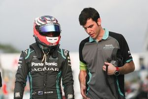 Mitch Evans, Panasonic Jaguar Racing, walks with a team member.