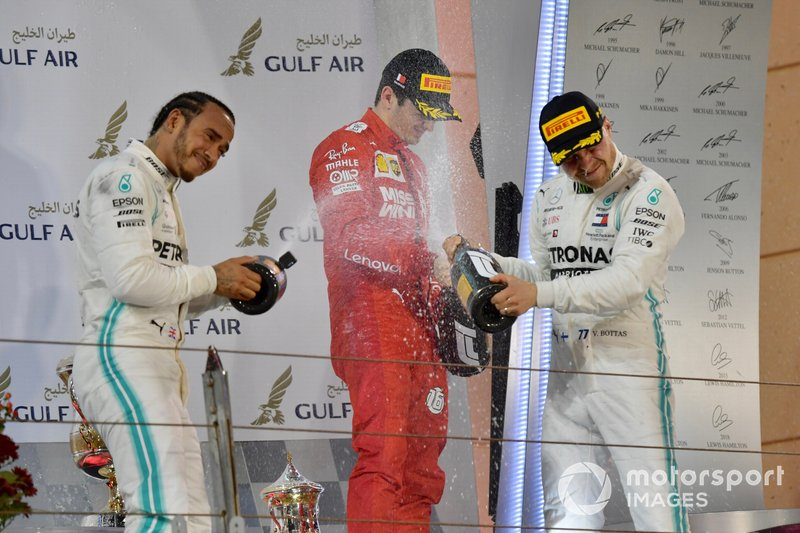 Lewis Hamilton, Mercedes AMG F1, 1st position, Charles Leclerc, Ferrari, 3rd position, and Valtteri Bottas, Mercedes AMG F1, 2nd position, spray Champagne on the podium