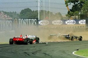 Crash: Michael Schumacher, Ferrari F310; Rubens Barrichello, Stewart SF01