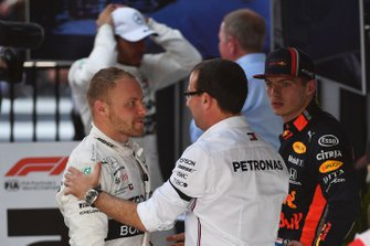 Valtteri Bottas, Mercedes AMG F1, 1st position, receives congratulations from a team mate for his win