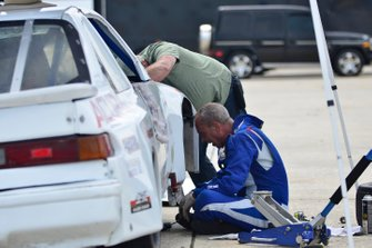 Crew members work on the #137 MP4A Acura Integra driven by Herbert Gomez