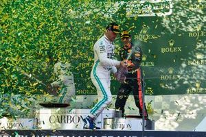 Valtteri Bottas, Mercedes AMG F1, 1st position, sprays the victory Champagne as confetti falls