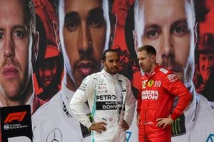 Lewis Hamilton, Mercedes AMG F1, 1st position, and Sebastian Vettel, Ferrari, 3rd position, talk in Parc Ferme