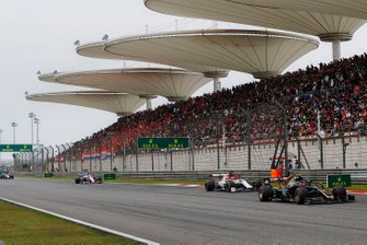 Kevin Magnussen, Haas F1 Team VF-19, leads Kimi Raikkonen, Alfa Romeo Racing C38, and Lance Stroll, Racing Point RP19