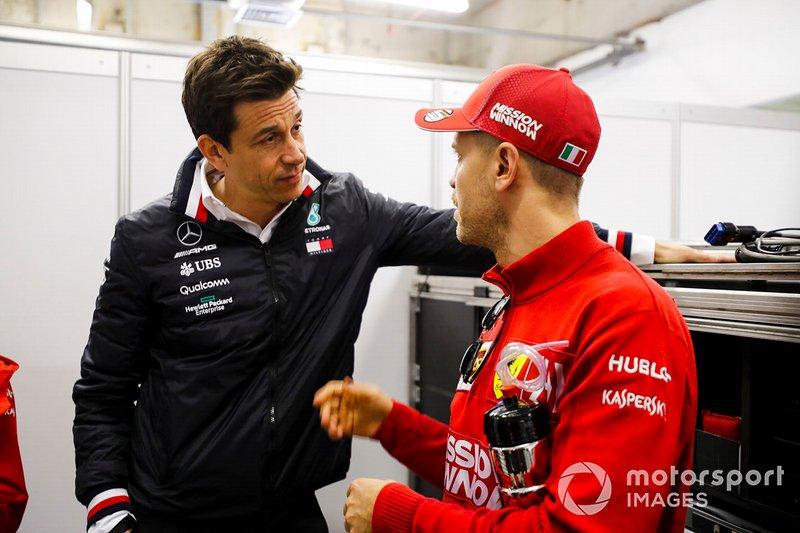 Toto Wolff, Direttore Esecutivo (Business), Mercedes AMG e Sebastian Vettel, Ferrari