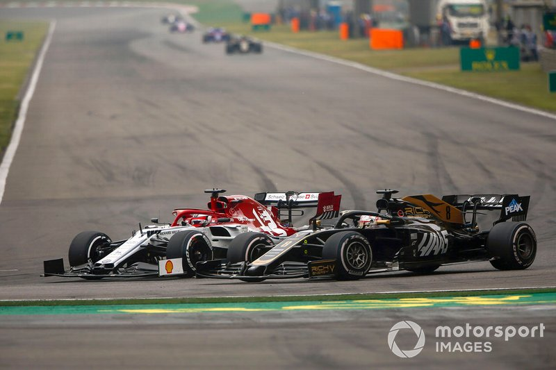 Kimi Raikkonen, Alfa Romeo Racing C38, battles with Romain Grosjean, Haas F1 Team VF-19