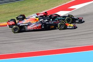 Max Verstappen, Red Bull Racing RB16B, battles with Lewis Hamilton, Mercedes W12, at the start