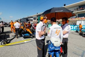 Lando Norris, McLaren, talks with engineers on the grid