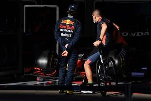 Sergio Perez, Red Bull Racing, with a team member outside the garage