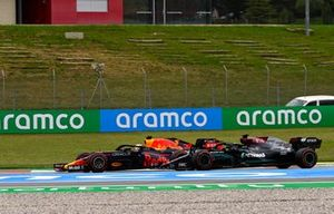Max Verstappen, Red Bull Racing RB16B, passes Sir Lewis Hamilton, Mercedes W12, for the lead on the opening lap