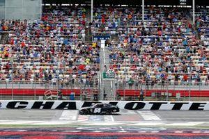 Ty Giibs, Joe Gibbs Racing, Toyota Supra Joe Gibbs Racing drives under the checkered flag to win