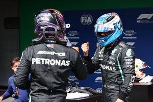 Lewis Hamilton, Mercedes, congratulates pole man Valtteri Bottas, Mercedes, in Parc Ferme
