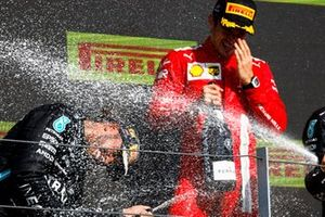 hp, 1st position, and Charles Leclerc, Ferrari, 2nd position, spray Champagne on the podium