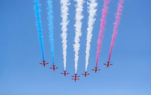 The RAF Aerobatics team, the Red Arrows, display for the crowds in their BAE Systems Hawk T.Mk.1As