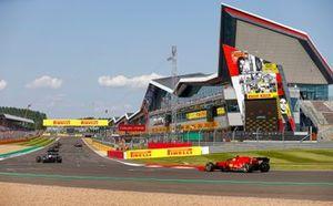 Fernando Alonso, Alpine A521, and Carlos Sainz Jr., Ferrari SF21, take their places on the grid for the restart
