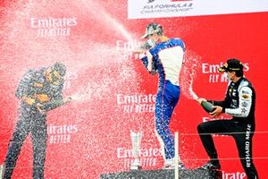 Dennis Hauger, Prema Racing, Race Winner Jack Doohan, Trident and Caio Collet, MP Motorsport celebrate on the podium with champagne