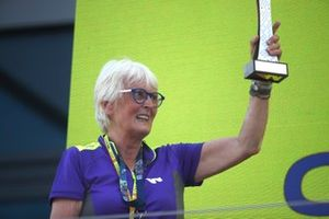 Motor racing veteran Annie Bradshaw collects the teams trophy on the podium