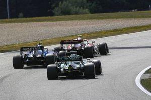 Antonio Giovinazzi, Alfa Romeo Racing C41, Nicholas Latifi, Williams FW43B, and Lance Stroll, Aston Martin AMR21
