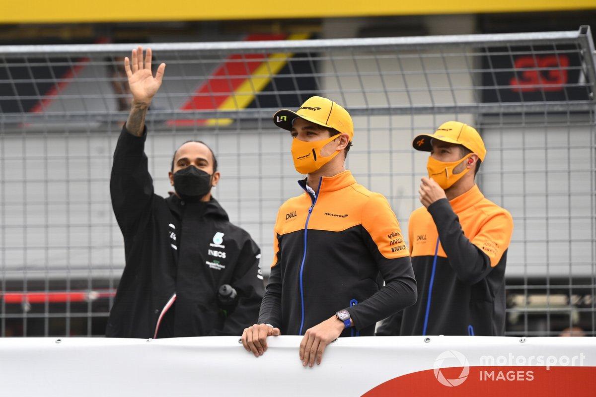 Lewis Hamilton, Mercedes, Lando Norris, McLaren, and Daniel Ricciardo, McLaren, at the drivers parade