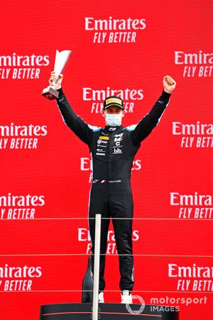Race winner Victor Martins, MP Motorsport celebrates on the podium with the trophy