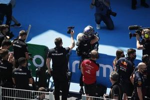 Lewis Hamilton, Mercedes, is congratulated by his team after taking his 100th pole position