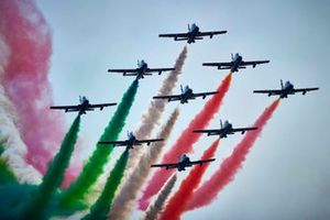 The Italian Air Force display team Frecce Tricolri perform for the crowd in their Aermacchi MB339A's prior to the start