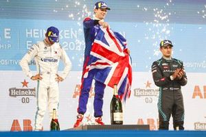 Nyck de Vries, Mercedes-Benz EQ, 2nd position, Alex Lynn, Mahindra Racing, 1st position, with a Union flag, Mitch Evans, Jaguar Racing, 3rd position, on the podium