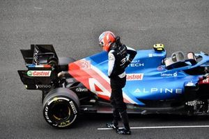 Esteban Ocon, Alpine A521, climbs out of his car after stopping on the grid at the end of FP2 with technical issues