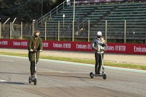 Valtteri Bottas, Mercedes-AMG F1, rides the track on a scooter with his girlfriend Tiffany Cromwell