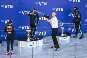 Max Verstappen, Red Bull Racing, 2nd position, Valtteri Bottas, Mercedes-AMG F1, 1st position, the Mercedes trophy delegate and Lewis Hamilton, Mercedes-AMG F1, 3rd position, celebrate with Champagne on the podium