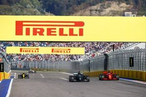 Lewis Hamilton, Mercedes F1 W11, passes Sebastian Vettel, Ferrari SF1000, ahead of Esteban Ocon, Renault F1 Team R.S.20