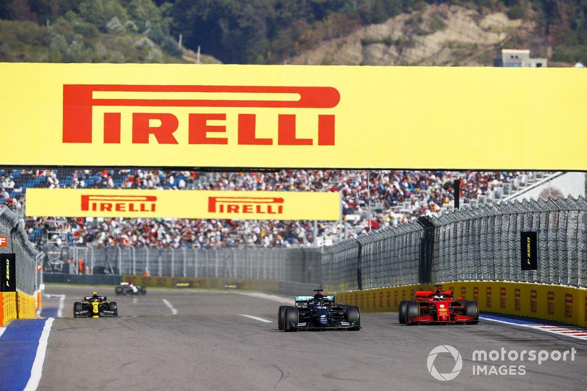 Lewis Hamilton, Mercedes F1 W11, passes Sebastian Vettel, Ferrari SF1000, Esteban Ocon, Renault F1 Team R.S.20