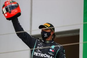 Lewis Hamilton, Mercedes-AMG F1, 1st position, with a helmet worn by Michael Schumacher in 2012