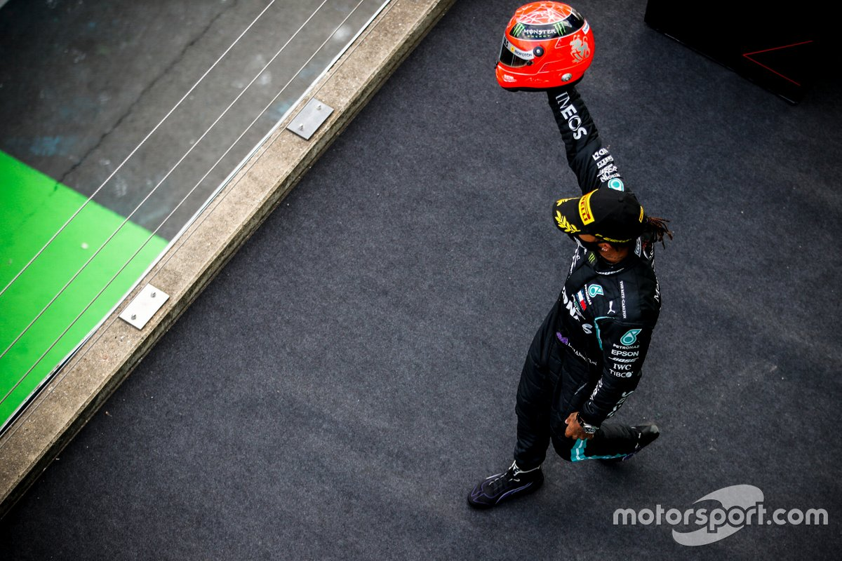 Lewis Hamilton, Mercedes-AMG Petronas F1, 1st position, on the podium with the helmet of Michael Schumacher