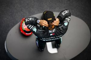 Lewis Hamilton, Mercedes-AMG F1, 1st position, on the podium with the helmet of Michael Schumacher