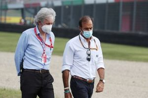 Emanuele Pirro, FIA steward, walks the track