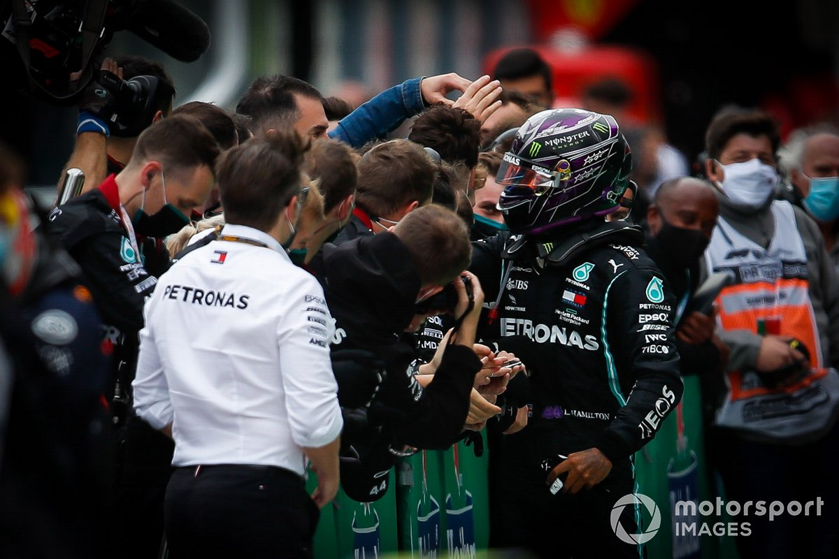 Lewis Hamilton, Mercedes-AMG F1, 1st position, celebrates with his team in Parc Ferme after securing his record breaking 92nd win